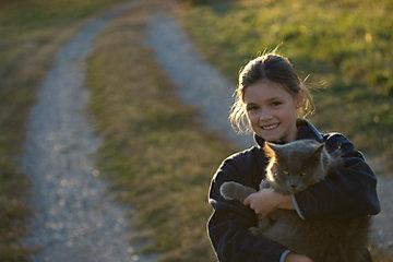 Girl holding long hair cat.
