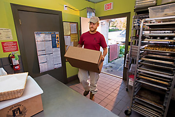 Terrell delivering a box to a local restaurant