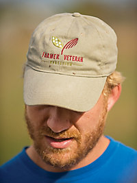 Terrell's hat with the Farmer Veteran Coalition logo