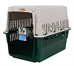 40-inch high plastic dog kennel with a wire door