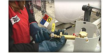 TSC Employee Refilling Propane Tank