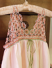 a flower girl's dress made with lace
