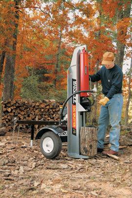 a man using a log splitter