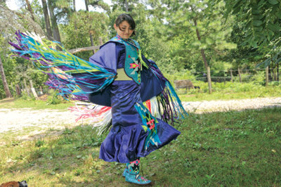 Cecilia in her brightly colored costume for the powwows