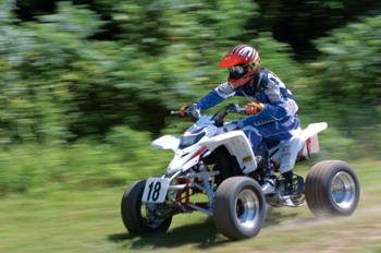 Christian racing on his ATV