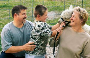 John, Gabriel and Martorana with one of the alpacas
