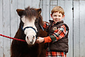 young Shaun Rawlings with a pony
