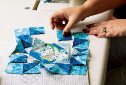 piecing together a quilt block