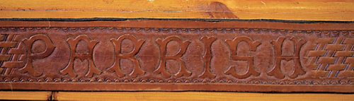 The Parrish name working in leather and framed with wood