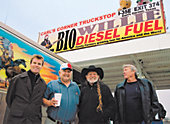Willie and friends in front of a truckstop that sells his fuel