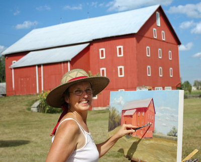 Gwen painting a barn