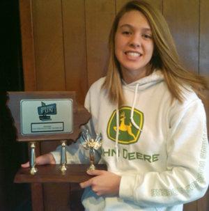 Jennifer Klindt showing an award she won