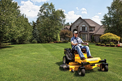 man mowing his lawn with a Cub Cadet riding mower