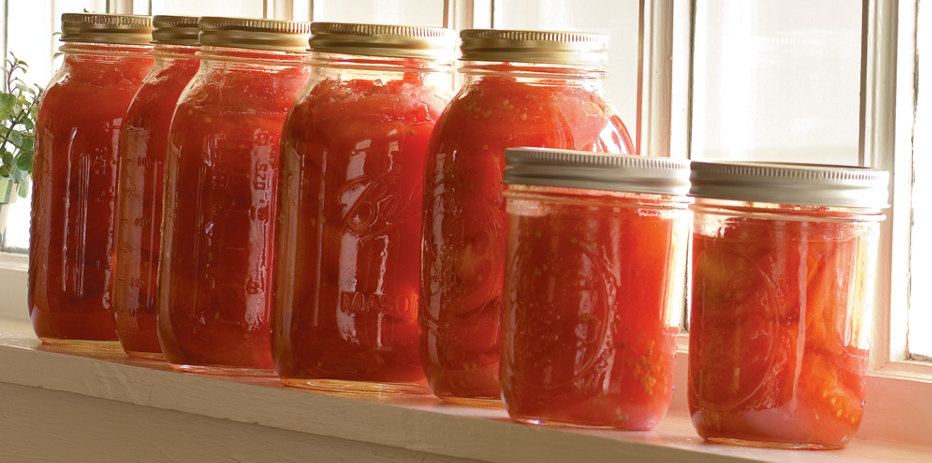 home-canned tomatoes in jars on window sill