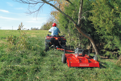 an ATV with a pull-behind mower attachment