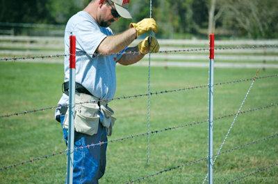 rancher measuring fencing