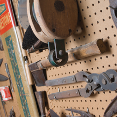 a number of antique tools organized on a wall
