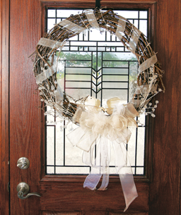 a decorated grapevine wreath
