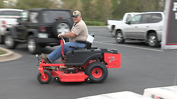 Customer test driving zero-turn lawn mower
