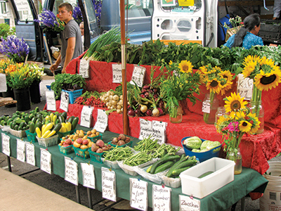 a variety of produce on display at a farmers market