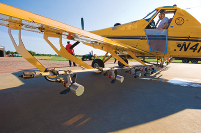 under the wing view of a crop dusting plane at rest