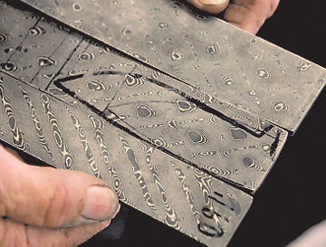 a pattern drawn on a layer of Damascus steel