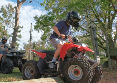 Two boys on ATVs