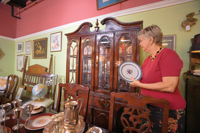 a consignment shop display with a dining room set