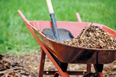 wheelbarrow with dirt