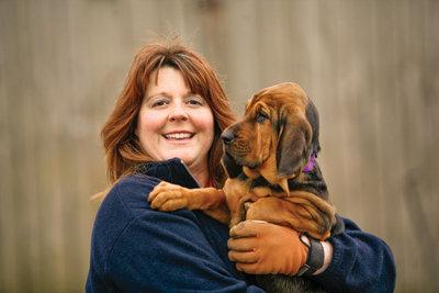 Susan with a bloodhound puppy
