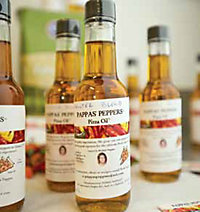bottles of Pappas' Peppers Pizza Oil