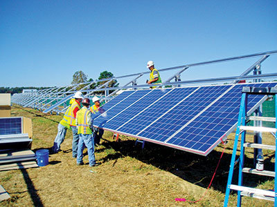 Construction workers putting solar panels together - Tractor Supply Co.
