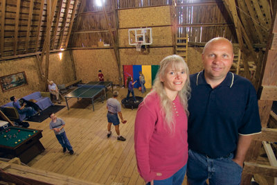 Marilyn and Doug Schafer with their converted loft in the background