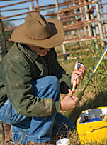 farmer measuring dosages for cattle meds