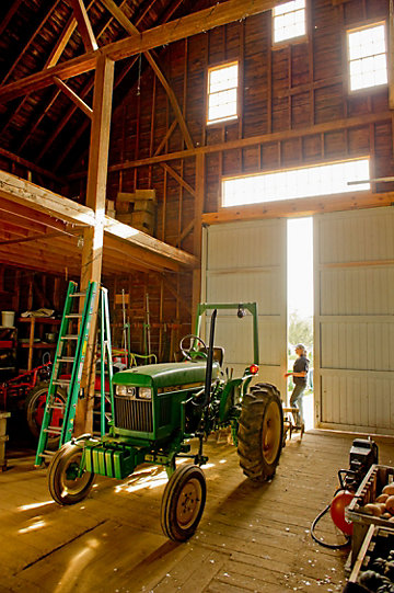 tractor parked inside a barn