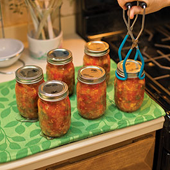 place the jars on a cooling rack (NO TIPPING)