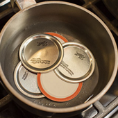 slightly boil the lids, then turn off the heat and let them soak