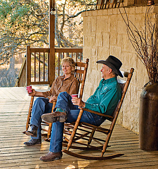 Chuck and Sharon sitting on rocking chairs on the pavilion porch
