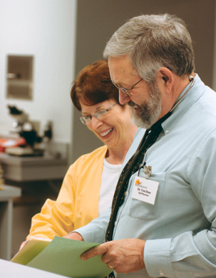 Dr. Dean with one of his nurses checking out a patient file