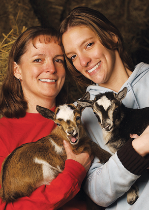 Janet and Hannah, each holding a goat