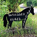sign for Sunkissed Acres
