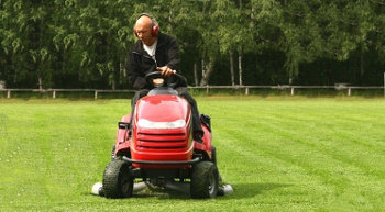 Cutting grass with riding lawn mover