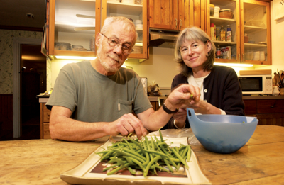 Dick and Pam snapping beans in the kitchen