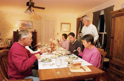 guests eating family style in the dining room