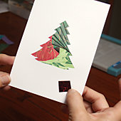 an iris-folded Christmas card in process