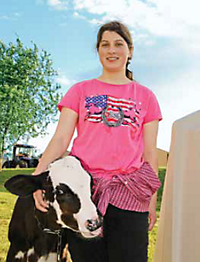 Katelyn with her arm around a calf