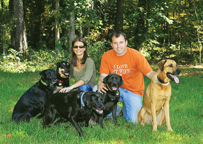 Ryan and Krissie with five of their dogs