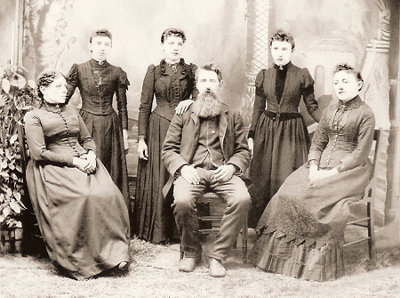the Ingalls family, left to right: Ma, Carrie, Laura, Pa, Grace, and Mary