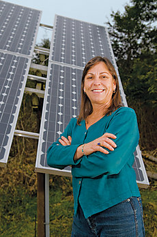 Linda against the backdrop of her solar panels