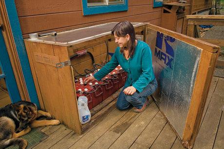 Linda Parkinson checking her solar batter system's water level